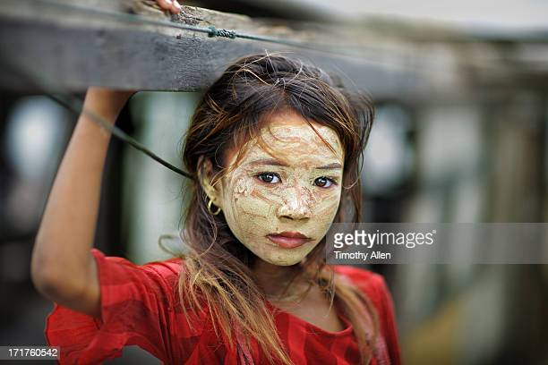 bajau sea gypsy girl with face pack - bajau stock pictures, royalty-free photos & images