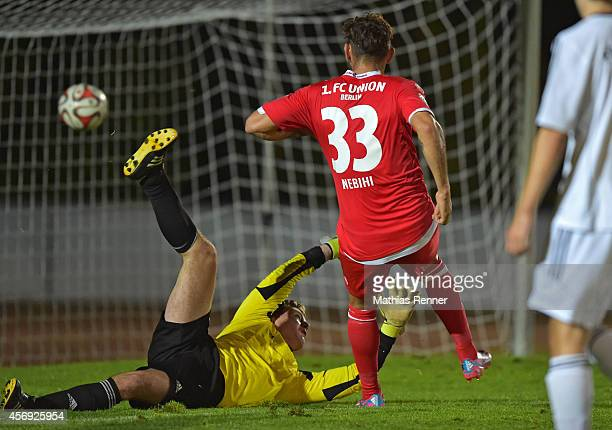 Bajram Nebihi of 1 FC. Union Berlin scores against Christopher Ewest of FC Strausberg during the friendly match between FC Strausberg and 1 FC Union...