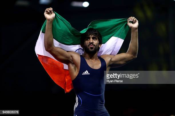 Bajrang of India celebrates victory over Kane Charig of Wales in the Men's Freestyle 65 kg Gold Medal match on day nine of the Gold Coast 2018...