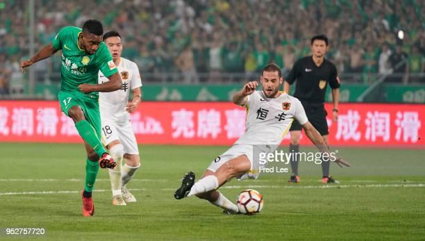 Bakambu of Beijing Guoan and Mario Suarez of Guizhou Hengfeng Zhicheng during 2018 China Super League match between Beijing Guoan and Guizhou...