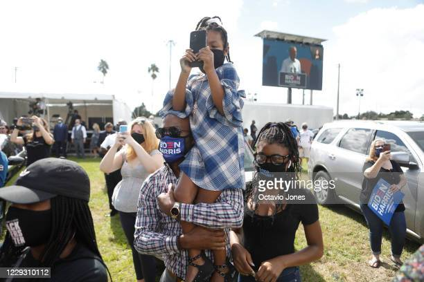 Bakari Burns of the Orlando City Commission, looks on with two daughters Adira Burns and Addison Burns while former President Barack Obama campaigns...