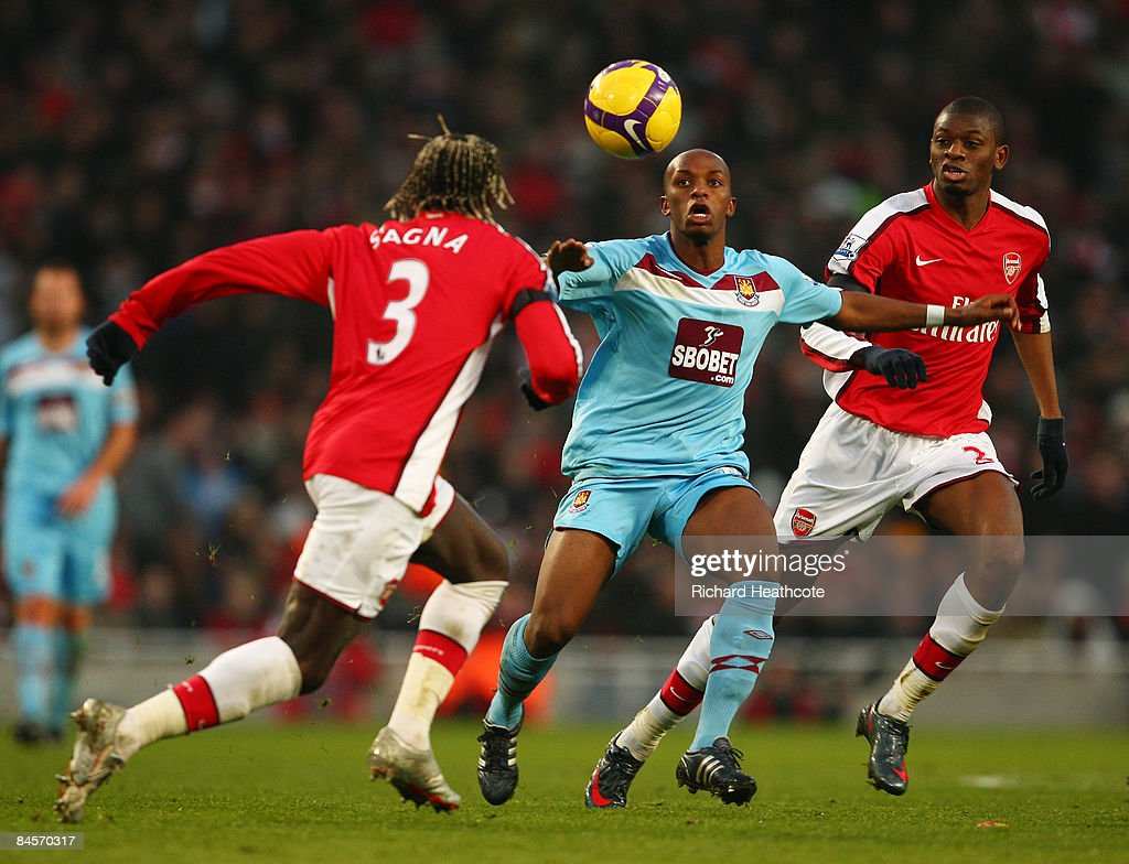 Bakari Sagna and Vassiriki Diaby of Arsenal challenge Savio Nsereko of West Ham United during the Barclays Premier League match between Arsenal and West Ham United at the Emirates Stadium on January 31, 2009 in London, England.