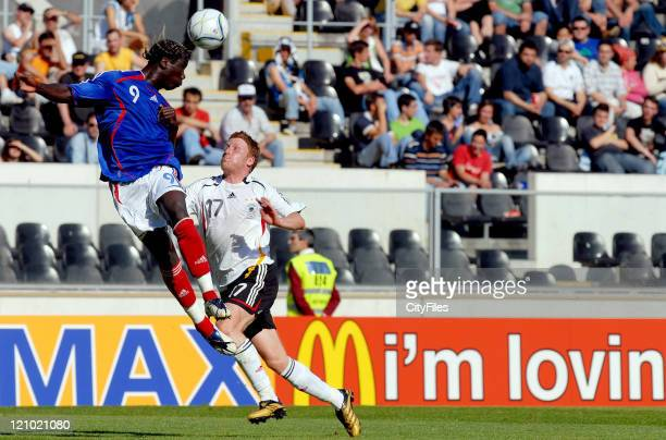Bakari Sagna of France and Pratick Ochs of Germany during the 2006 UEFA European Under 21 Championship Group A match between France and Germany in...