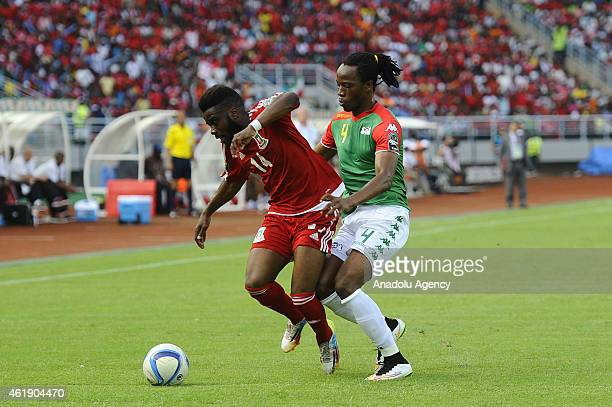 Bakary Kone of Burkina Faso in action against Enrique Boula Senobua of Equatorial Guinea at Bata stadium ahead of the 2015 African Cup of Nations...