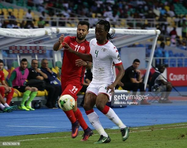 Bakary Kone of Burkina Faso vies with Yassine Khenissi during the 2017 Africa Cup of Nations quarterfinal football match between Burkina Faso and...