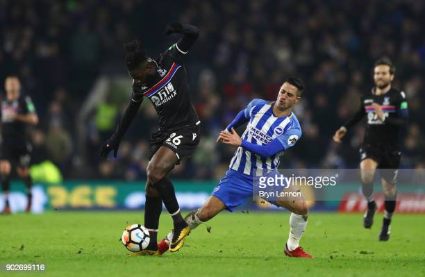 Bakary Sako of Crystal Palace battles with Biram Kayal of Brighton and Hove Albion during The Emirates FA Cup Third Round match between Brighton Hove...