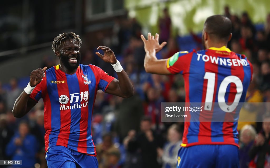 Bakary Sako of Crystal Palace celebrates scoring his sides first goal with Andros Townsend of Crystal Palace during the Carabao Cup Third Round match between Crystal Palace and Huddersfield Town at Selhurst Park on September 19, 2017 in London, England.