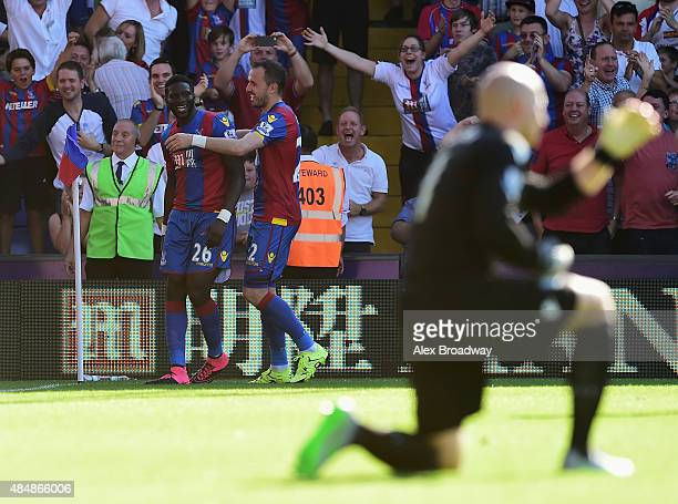 Bakary Sako of Crystal Palace celebrates scoring his team's second goal with his team mate Jordon Mutch during the Barclays Premier League match...