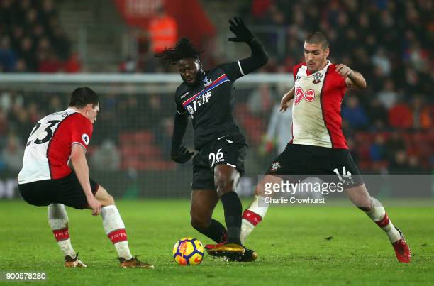 Bakary Sako of Crystal Palace is challenged by Oriol Romeu of Southampton and PierreEmile Hojbjerg of Southampton during the Premier League match...