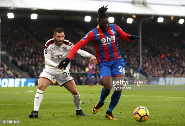 Bakary Sako of Crystal Palace is challenged by Phil Bardsley of Burnley during the Premier League match between Crystal Palace and Burnley at...