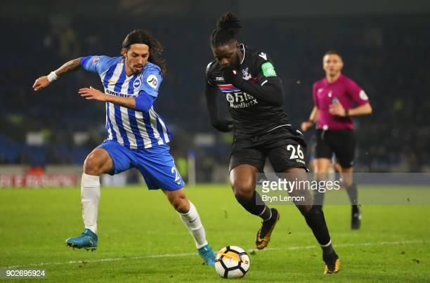 Bakary Sako of Crystal Palace is chased by Matias Ezequiel Schelotto of Brighton and Hove Albion during The Emirates FA Cup Third Round match between...