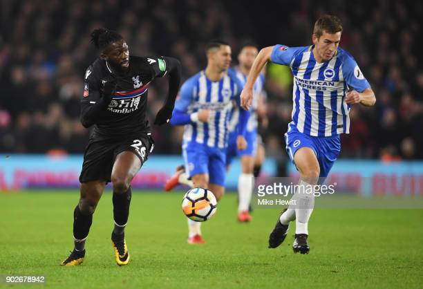 Bakary Sako of Crystal Palace is chased by Uwe Huenemeier of Brighton and Hove Albion during The Emirates FA Cup Third Round match between Brighton...
