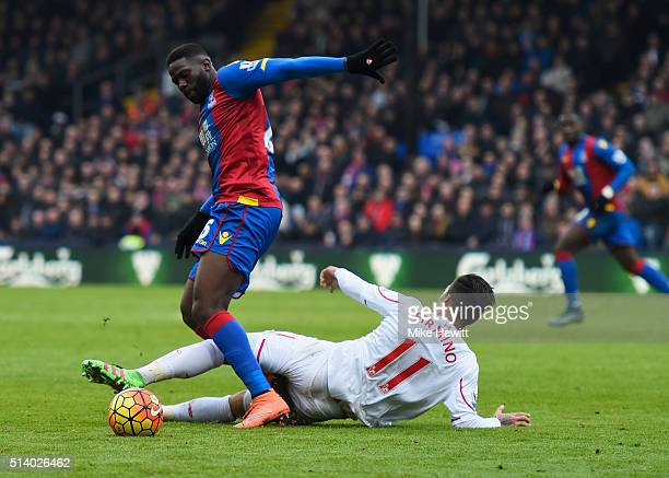 Bakary Sako of Crystal Palace is tackled by Roberto Firmino of Liverpool during the Barclays Premier League match between Crystal Palace and...
