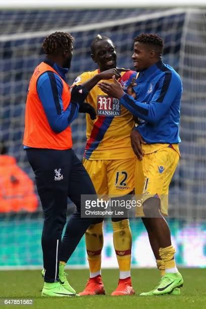 Bakary Sako of Crystal Palace Mamadou Sakho of Crystal Palace and Wilfried Zaha of Crystal Palace celebrate after the game during the Premier League...