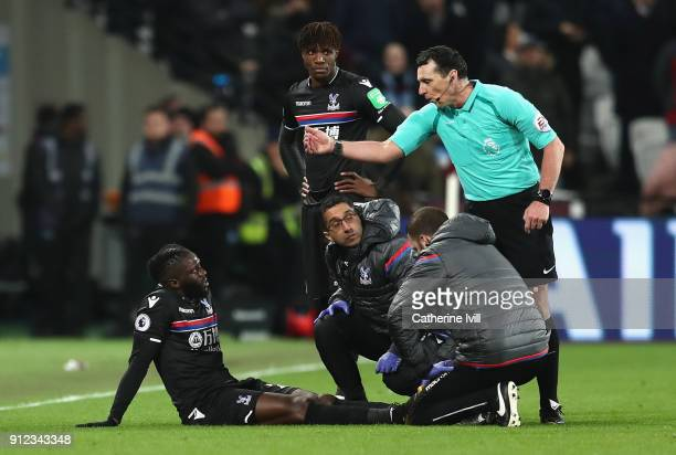 Bakary Sako of Crystal Palace recieves treatment following an injury during the Premier League match between West Ham United and Crystal Palace at...