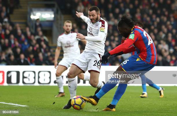 Bakary Sako of Crystal Palace scores his sides first goal as Phil Bardsley of Burnley attempts to block during the Premier League match between...