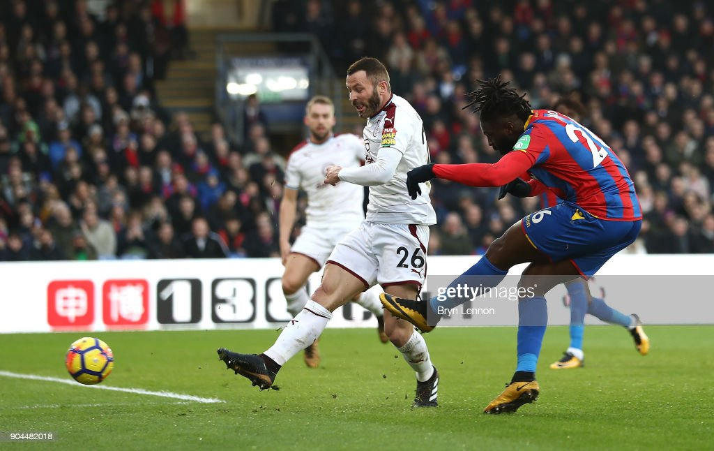 Bakary Sako of Crystal Palace scores his sides first goal as Phil Bardsley of Burnley attempts to block during the Premier League match between Crystal Palace and Burnley at Selhurst Park on January 13, 2018 in London, England.