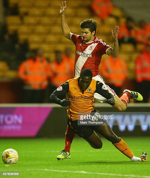 Bakary Sako of Wolverhampton Wanderers is brought down by George Friend of Middlesbrough for a penalty during the Sky Bet Championship match between...