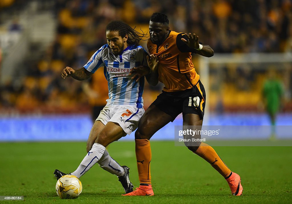 Bakary Sako of Wolverhampton Wanderers is challenged by Sean Scannell of Huddersfield Town challenges during the Sky Bet Championship match between Wolverhampton Wanderers and Huddersfield Town at Molineux on October 1, 2014 in Wolverhampton, England.