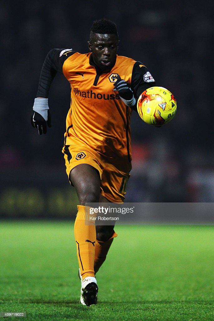 Bakary Sako of Wolverhampton Wanderers runs with the ball during the Sky Bet Championship match between Brentford and Wolverhampton Wanderers at Griffin Park on November 29, 2014 in Brentford, England.