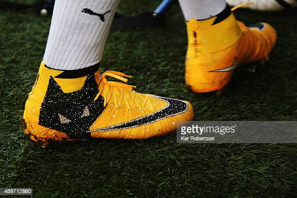 Bakary Sako of Wolverhampton Wanderers wears specially designed boots to commemorate his 100th game for Wolves as he warms up before the Sky Bet...