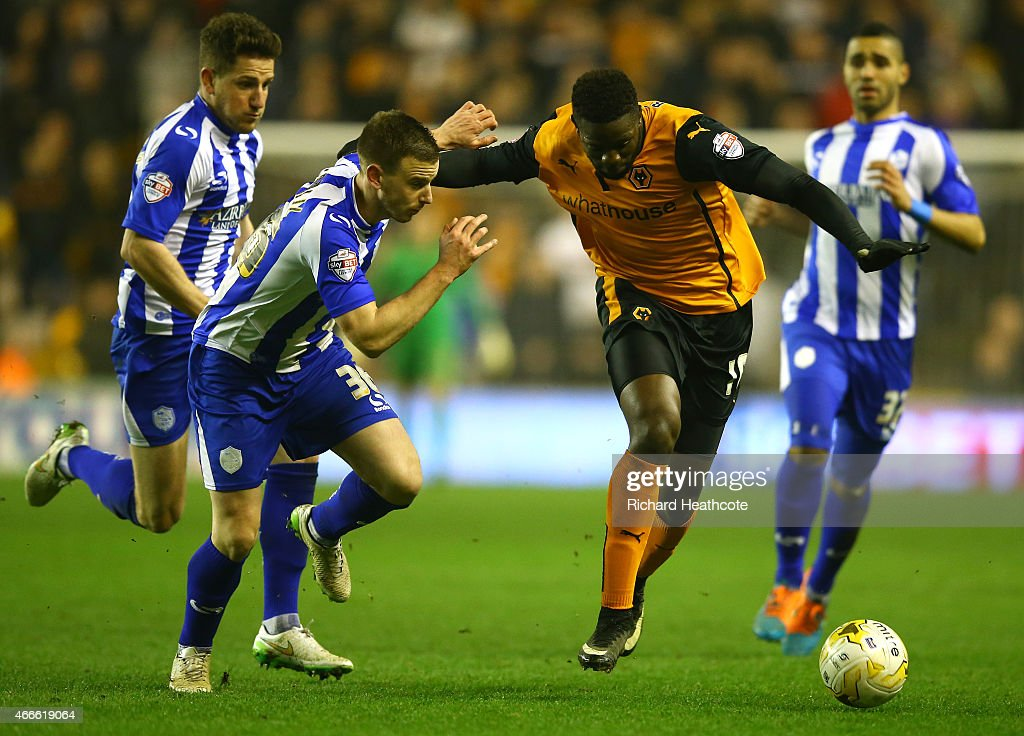 Bakary Sako of Wolves holds off Marnick Vermijl of Wednesday during the Sky Bet Championship match between Wolverhampton Wanderers and Sheffield Wednesday at Molineux on March 17, 2015 in Wolverhampton, England.