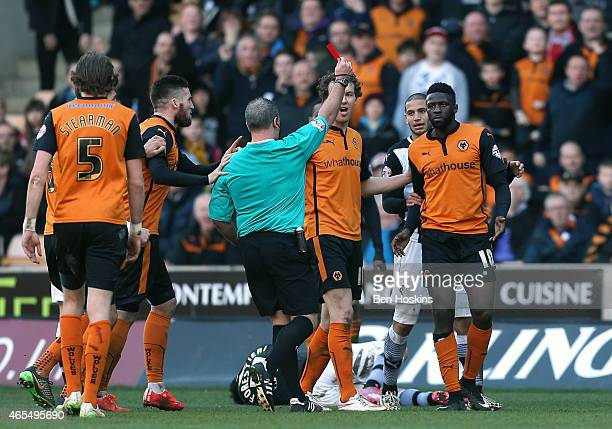 Bakary Sako of Wolves is sent off by referee Brendan Malone during the Sky Bet Championship match between Wolverhampton Wanderers and Watford at...