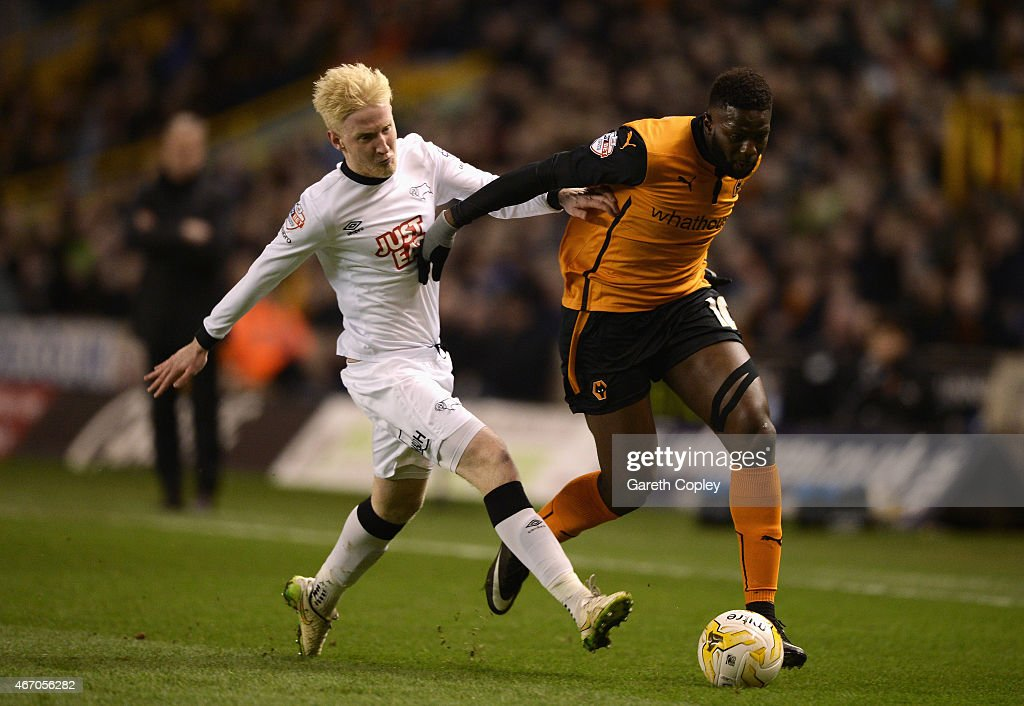 Bakary Sako of Wolves is tackled by Will Hughes of Derby during the Sky Bet Championship match between Wolverhampton Wanderers and Derby County at Molineux on March 20, 2015 in Wolverhampton, England.