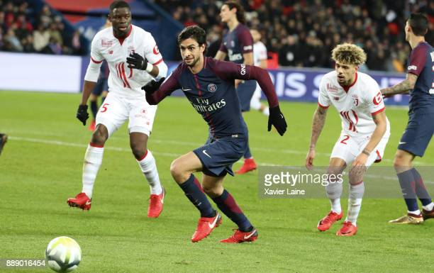 Bakary Soumaoro and Kevin Malcuit of Lille OSC in action with Javier Pastore of Paris SaintGermain during the Ligue 1 match between Paris Saint...