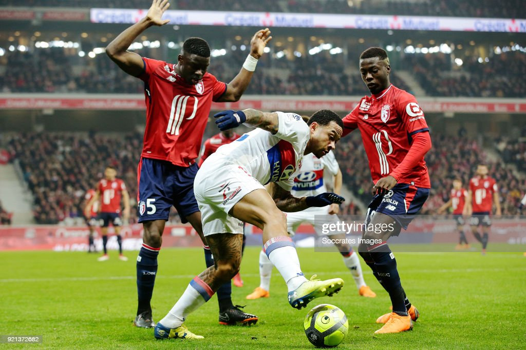 Bakary Soumaoro of Lille, Memphis Depay of Olympique Lyon, Nicolas Pepe of Lille during the French League 1 match between Lille v Olympique Lyon at the Stade Pierre Mauroy on February 18, 2018 in Lille France