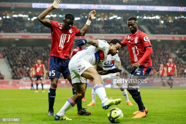 Bakary Soumaoro of Lille Memphis Depay of Olympique Lyon Nicolas Pepe of Lille during the French League 1 match between Lille v Olympique Lyon at the...