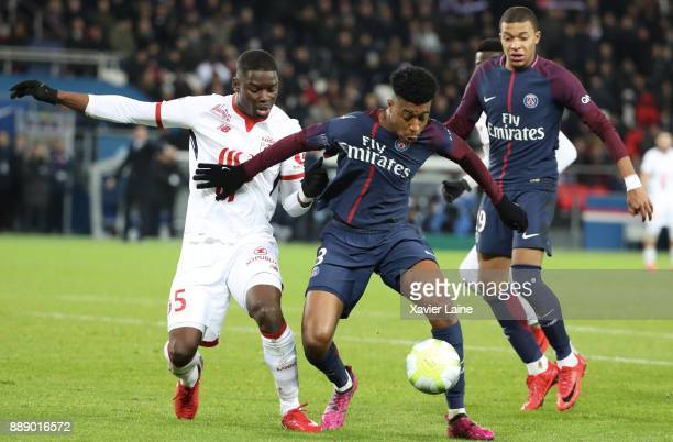 Bakary Soumaoro of Lille OSC in action with Presnel Kimpembe of Paris SaintGermain during the Ligue 1 match between Paris Saint Germain and Lille OSC...