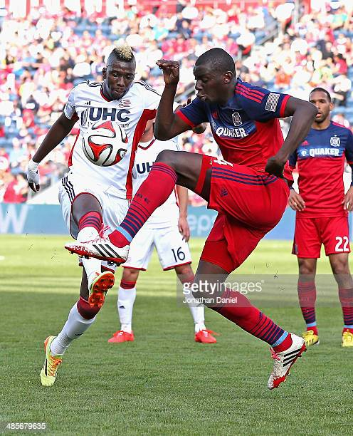 Bakary Soumare of the Chicago Fire and Saer Sene of the New England Revolution battle for the ball during an MLS match at Toyota Park on April19 2014...