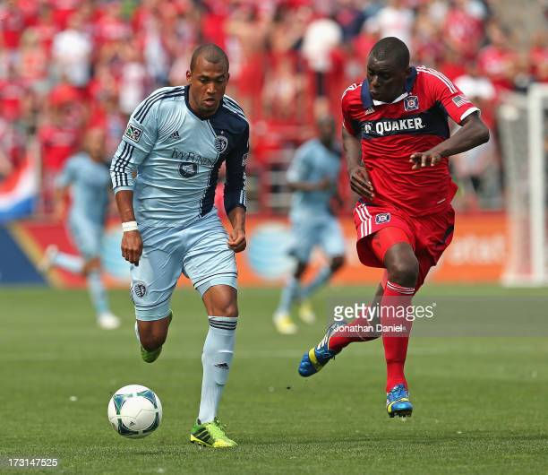 Bakary Soumare of the Chicago Fire and Teal Bunbury of Sporting Kansas City chase the ball during an MLS match at Toyota Park on July 7 2013 in...