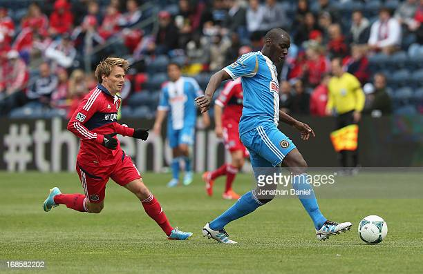 Bakary Soumare of the Philadelphia Union moves in front of Chris Rolfe of the Chicago Fire during an MLS match at Toyota Park on May 11 2013 in...