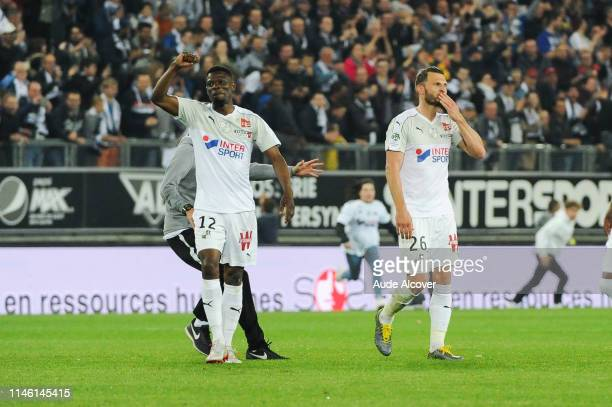 Bakaye Dibassy and Erik Pieters of Amiens celebrate victory during the Ligue 1 match between Amiens Sporting Club and EA Guingamp on May 24 2019 in...