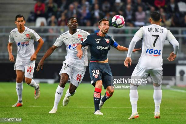 Bakaye Dibassy of Amiens and Romain Amalfitano of Dijon during the Ligue 1 match between Amiens and Dijon at Stade de la Licorne on October 6 2018 in...