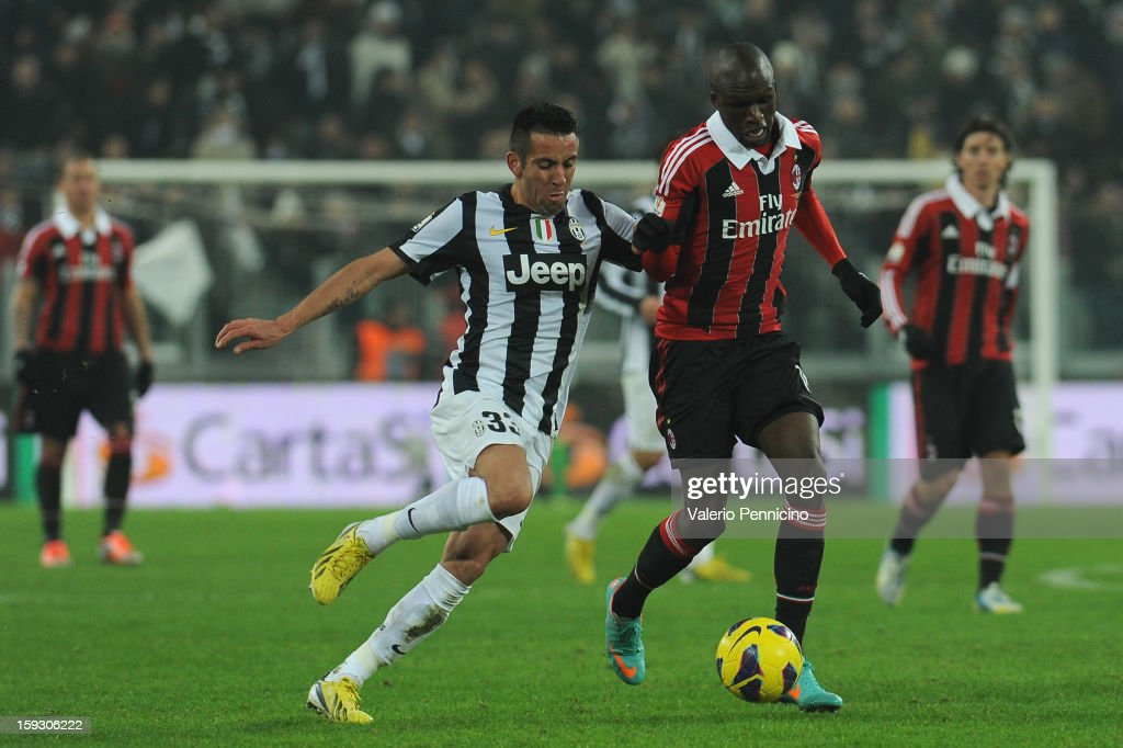 Bakaye Traore (R) of AC Milan in action against Mauricio Isla of Juventus FC during the TIM cup match between Juventus FC and AC Milan at Juventus Arena on January 9, 2013 in Turin, Italy.