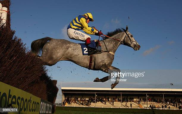 Bakbenscher ridden by Robert Thornton clears a fence on its way to winning the Weatherbys Bloodstock Insurance beginners Steeplechase at Wincanton...