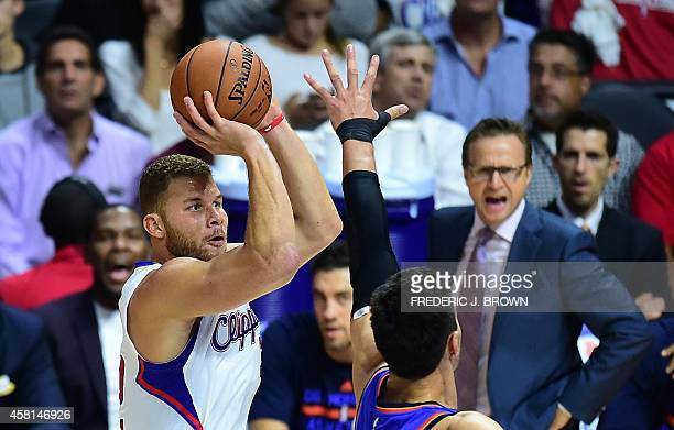 Bake Griffin of the Los Angeles Clippers shoots under pressure from Steven Adams of the Oklahoma City Thunder as an injured Kevin Durant and Thunder...