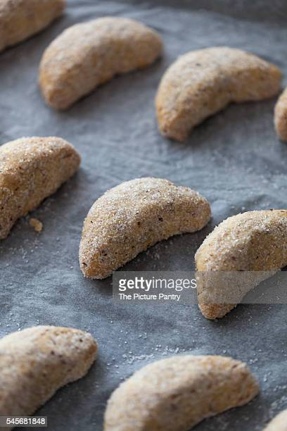 Baked Almond cresecent cookies on a baking tray