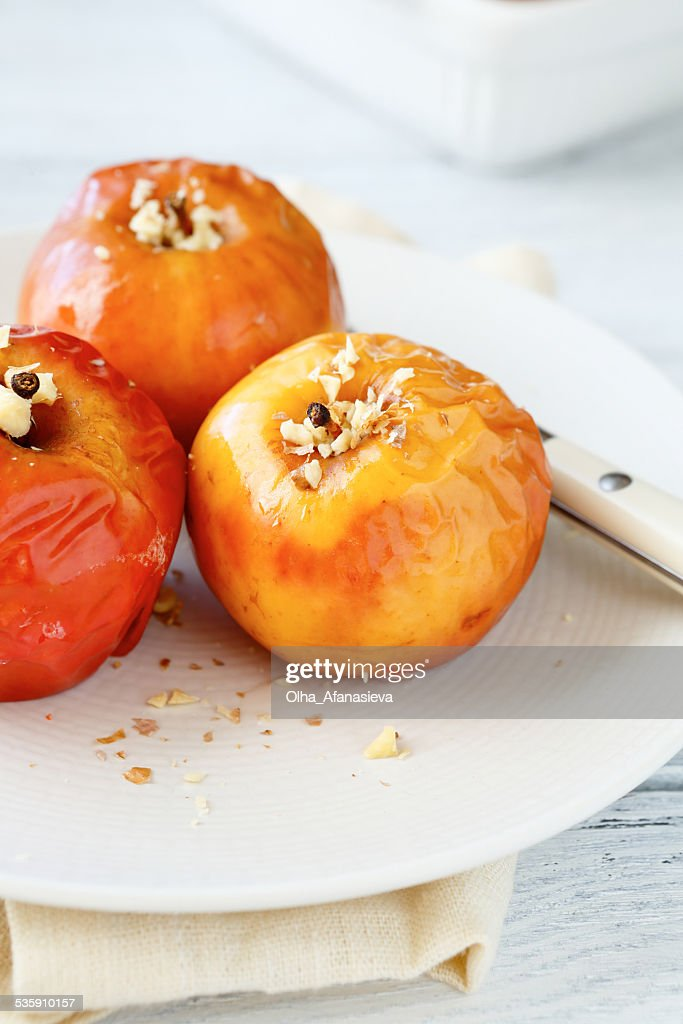 Baked apple on a white plate : Stock Photo
