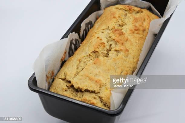 baked banana bread in a baking tray - rafael ben ari - fotografias e filmes do acervo