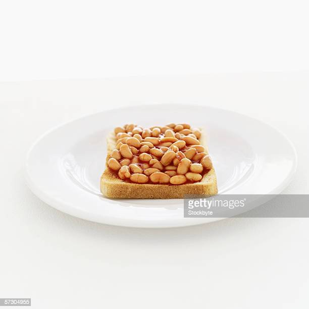 baked beans on toast served on a plate