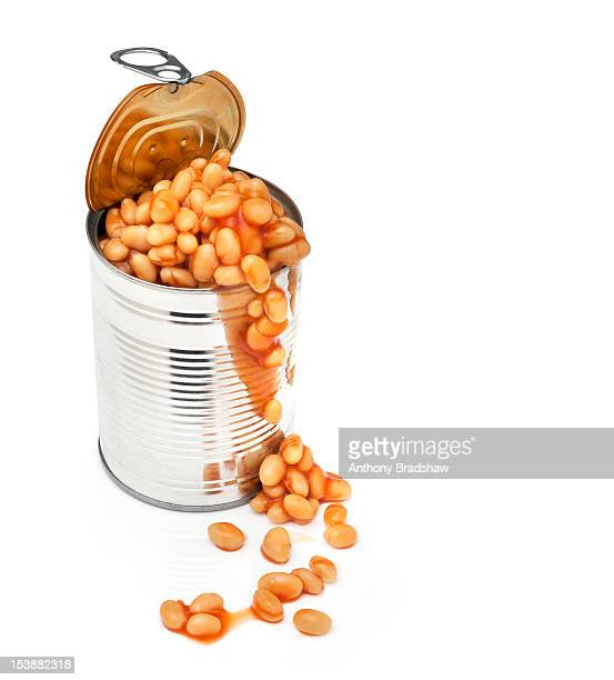 Baked beans spilling out of a tin can