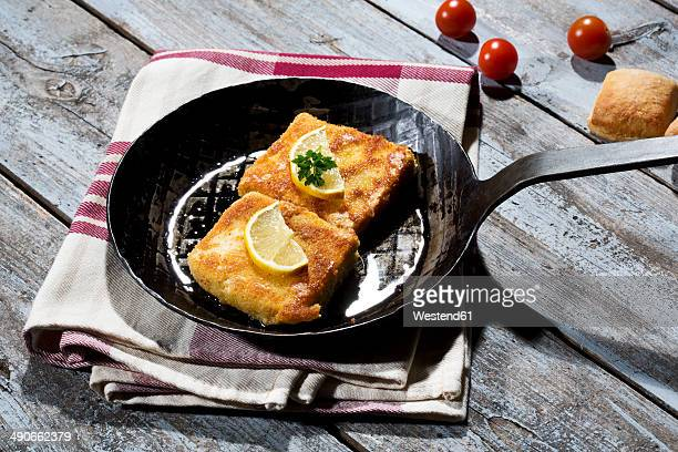 baked bio-tofu in a pan - breaded stock photos and pictures