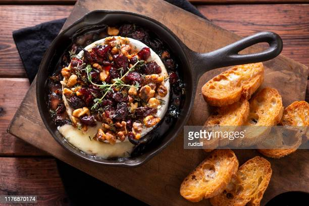 baked brie - cranberry stock pictures, royalty-free photos & images