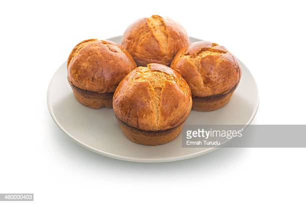Baked brioche rolls on a plate