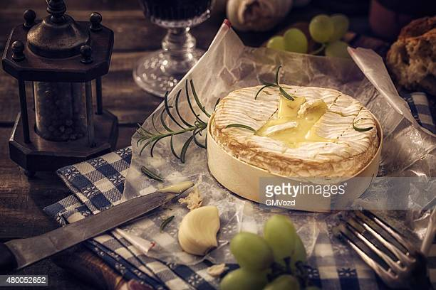 baked camembert cheese with garlic and rosemary - camembert stock photos and pictures