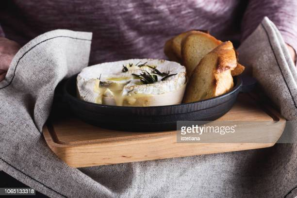 baked camembert with garlic and rosemary - camembert stock photos and pictures